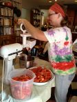 Squishing tomatoes is a messy job. The Kitchen Aid makes it much, much easier than last year's hand-crank food mill.